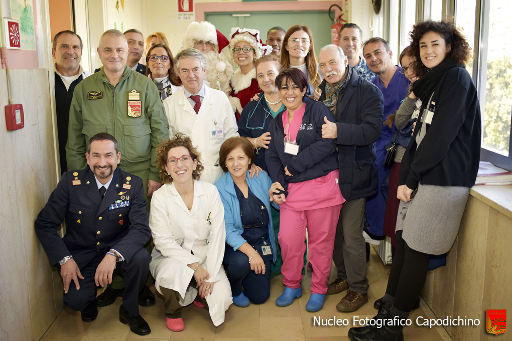 NAPLES, Italy (Dec. 15, 2016) Italian Air Force and U.S. Navy military personnel participate in a COMREL (Community Relations) event at children's hospital in the Naples, Italy area.